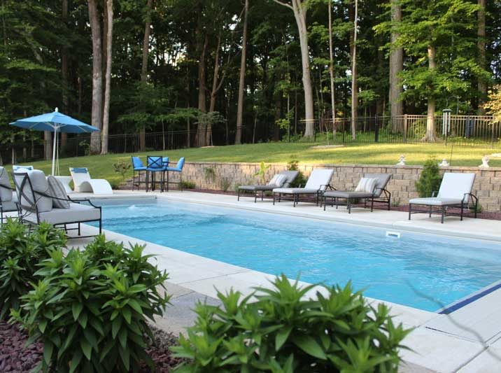 Lounge chairs surrounding inground pool