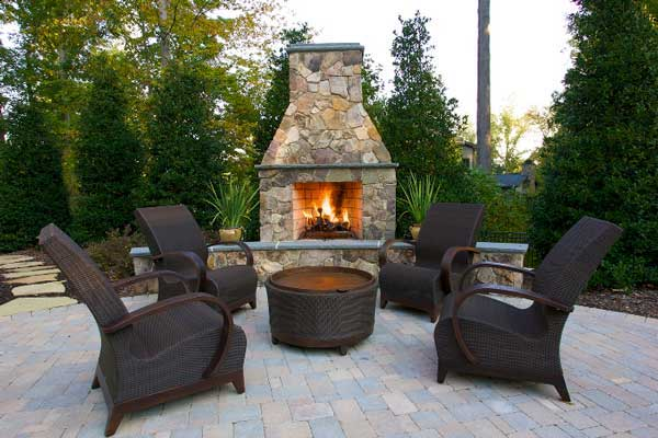 Outdoor Fireplace with furniture on brick patio