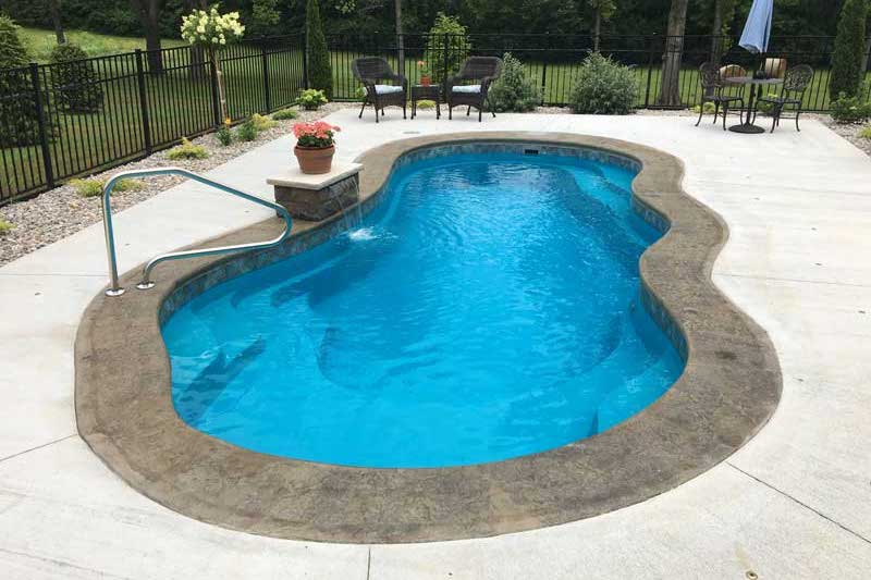 The Fantasy design swimming pool in cement patio with landscaping