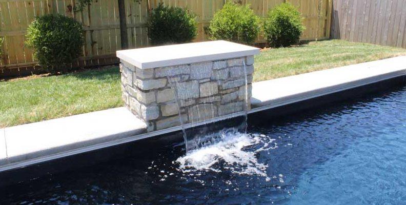 Stone Waterfall falling into Pool