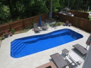 Aerial view of pacific fiberglass swimming pool in backyard