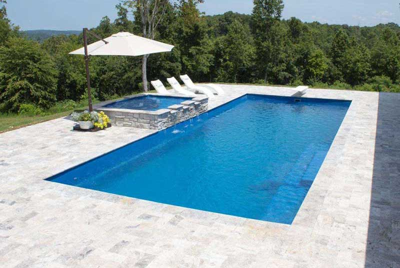 8' Depth Inground Swimming Pool with Trees in Background
