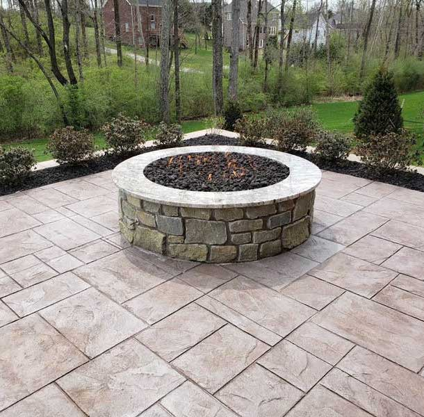 Firepit on Patio with Trees in the Background