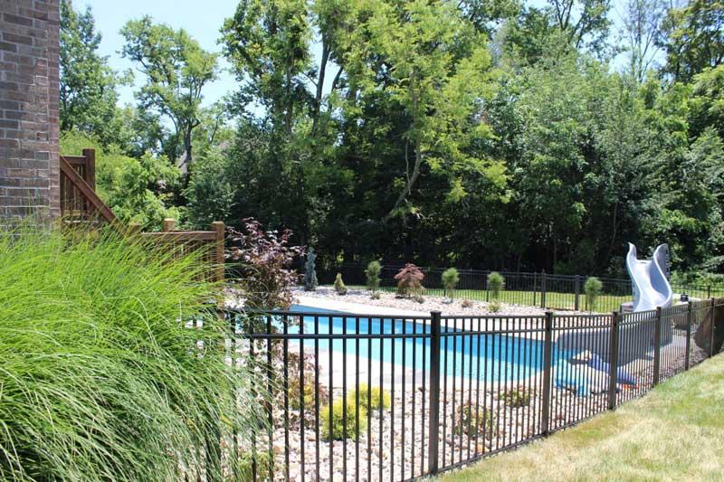 Landscape design around swimming pool with slide