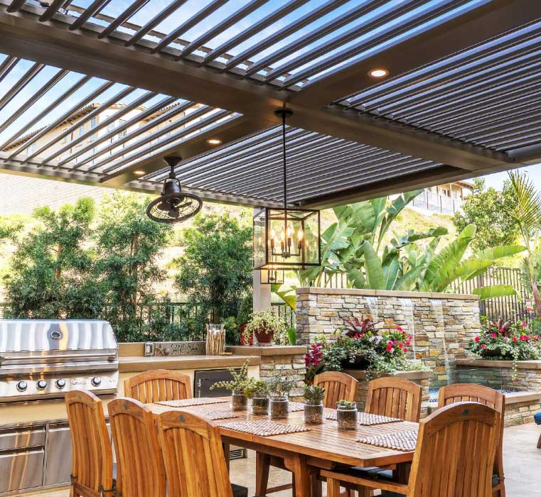 Louvered Roof over outdoor kitchen and dining area