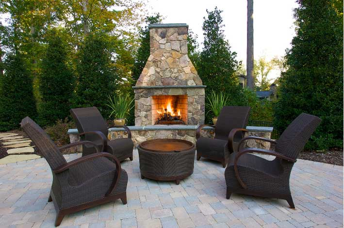 Outdoor Fireplace and Patio with rattan seating