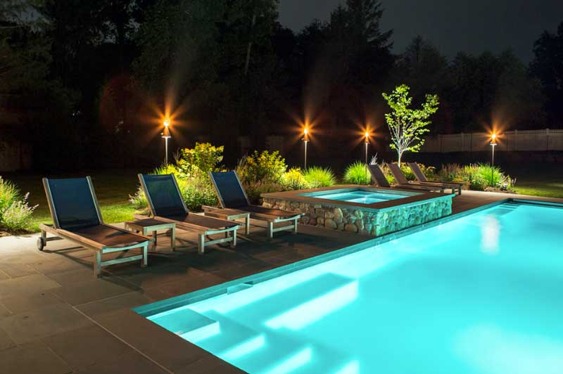 Night time view of Poolside with Lighting