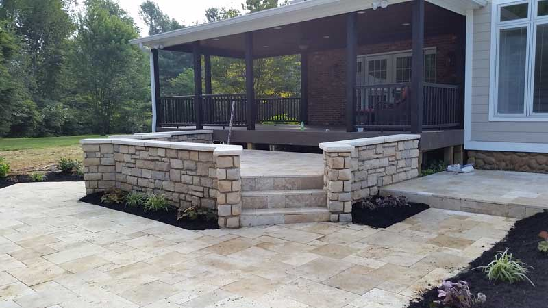 Travertine Elevated Patio near House in Wooded area