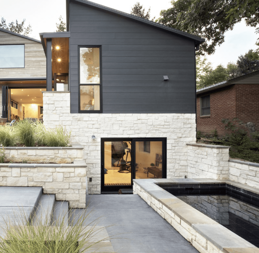 Soake Pool behind an urban brick and siding home with stone patio