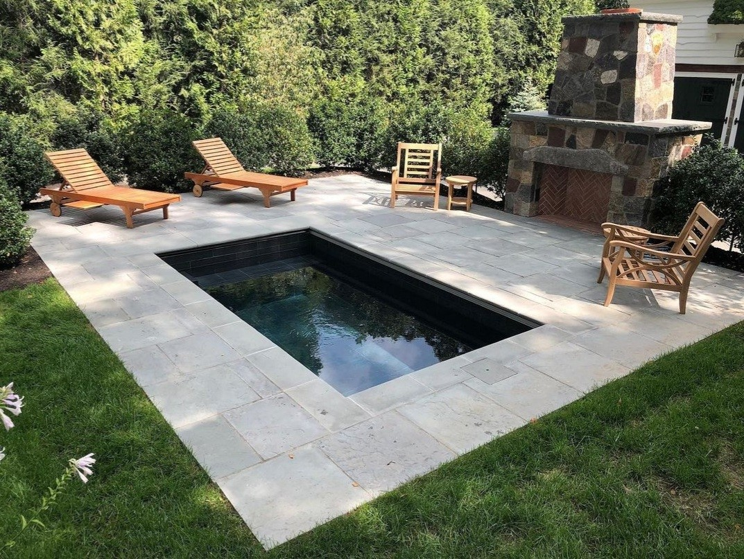 Cocktail pool with firepit and paver stone patio